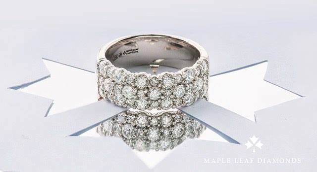 This ring is a ten-tabler! (You can see it 10 tables away.) Thirty-three VS2, H-I Canadian Maple Leaf Diamonds™ totalling 1.5ctw. WOW! Looks even more brilliant in person. (Also available in 2 and single row.)
